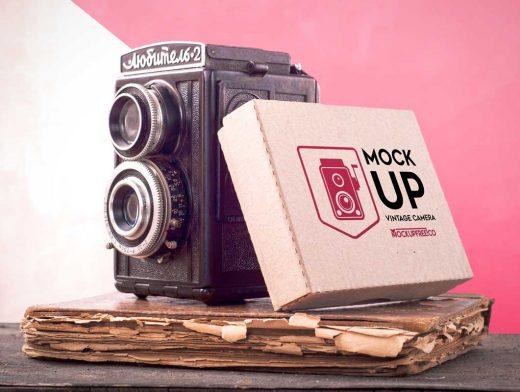 Vintage Camera And Box Packaging PSD Mockup